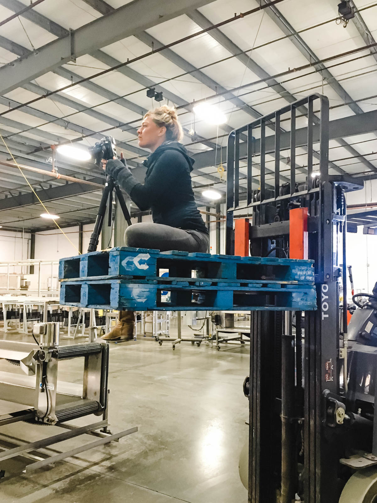 Dawn Heumann, Commercial Photographer on fork lift